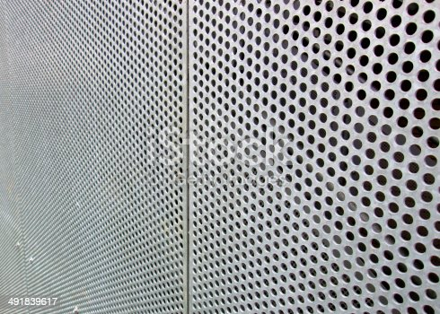 istock Image of perforated metal sheet with holes forming geometric pattern 491839617