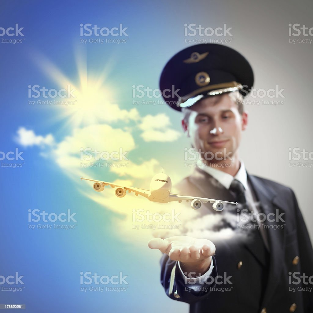 Image of pilot with plane in hand royalty-free stock photo