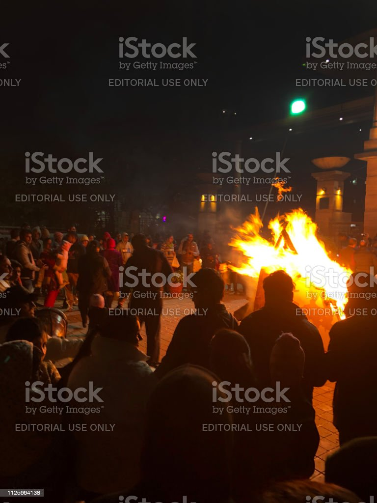 People crowded around the Lohri festival bonfire in celebration of...