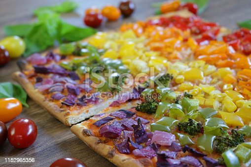 Photo showing a vegetarian kid's unicorn rectangular rainbow pizza, freshly baked in hot kitchen pizza oven and the perfect way to eat healthy. Concept photo for LGBT / lesbian gay pride.