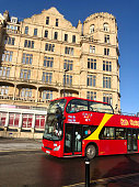 istock Image of red sightseeing, open-top bus in Bath city, Somerset, England 1301372802