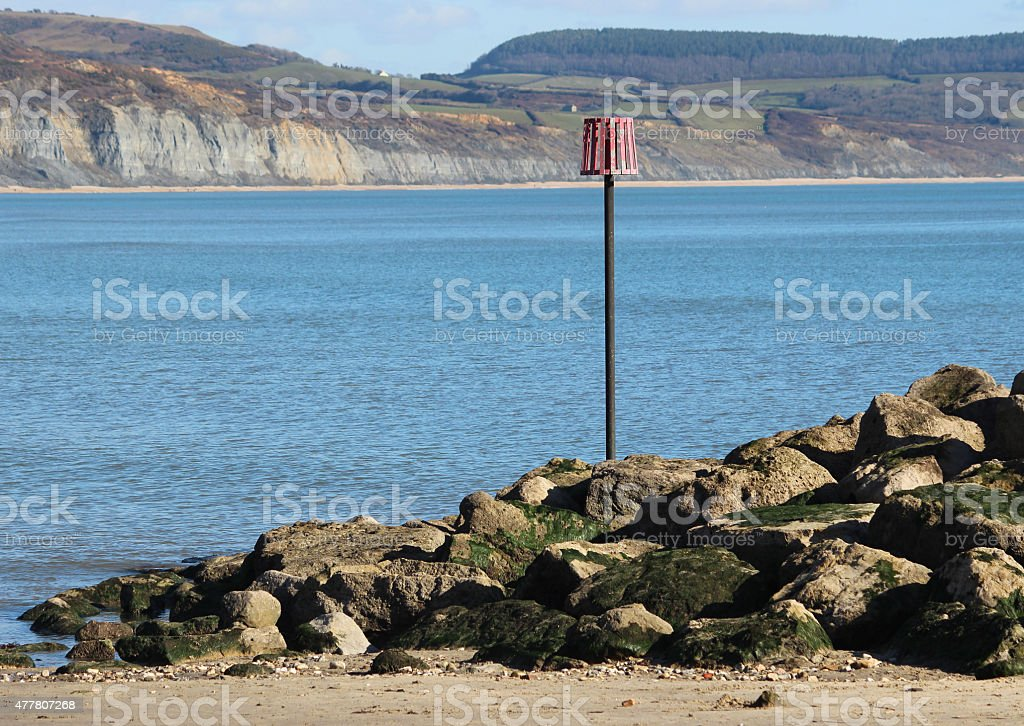 Image of rocks on beach, coastal erosion management, rock-armour riprap stock photo