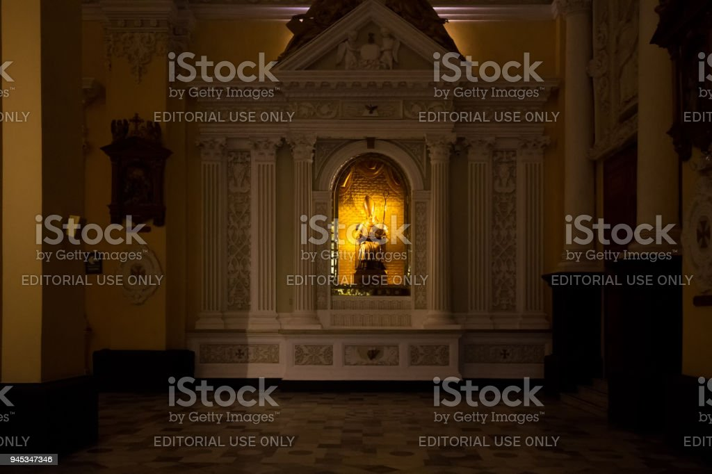 Image of Saint Toribio D Mogrovejo is illuminated in the darkness of the main chapel of the Cathedral of Arequipa stock photo