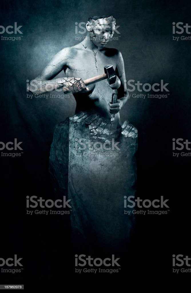 Image of sculpture mimicking sculptor stock photo