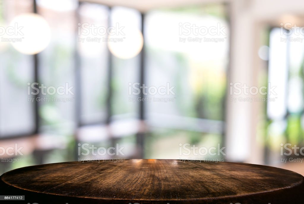 Image of Selected focus empty wooden table and Coffee shop or blurred cafe background of abstract with bokeh image. for montage or display your products royalty-free stock photo