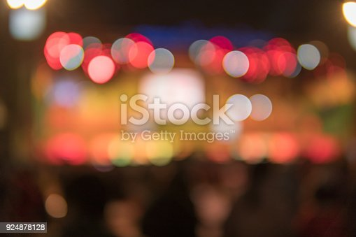 862429776 istock photo Image of shopping place with light blurred bokeh abstract background. Blurred colorful circles on light holiday background. 924878128