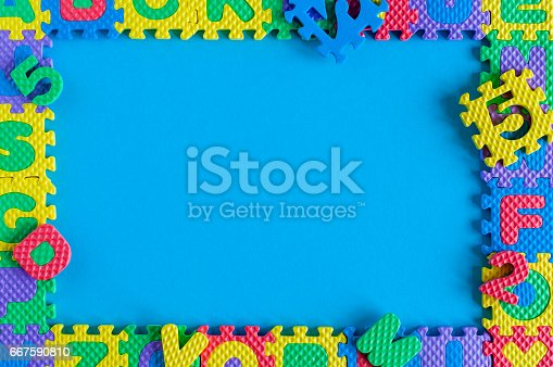 istock Image of simple poster frame of child toy puzzle. Mockup and template scene with blue background 667590810