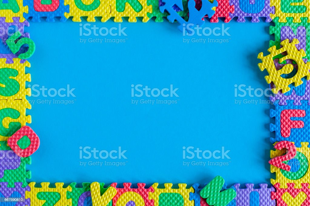 Image of simple poster frame of child toy puzzle. Mockup and template scene with blue background stock photo