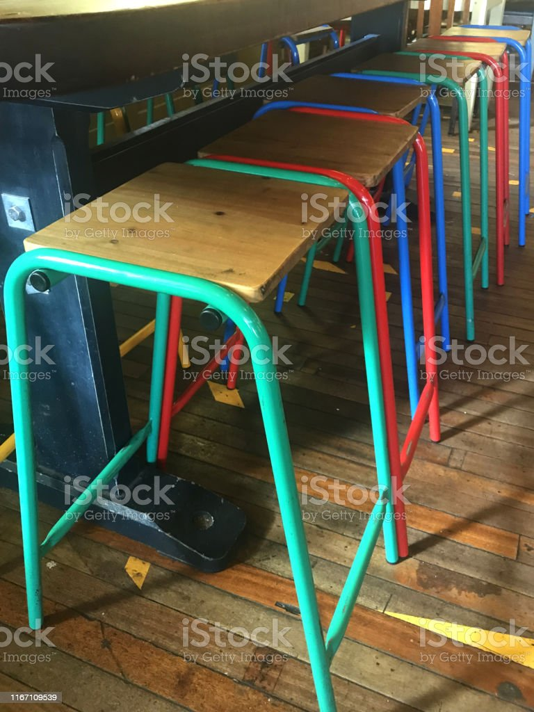 Image Of Six Rainbow Coloured Kitchen Stool In A Row Bar