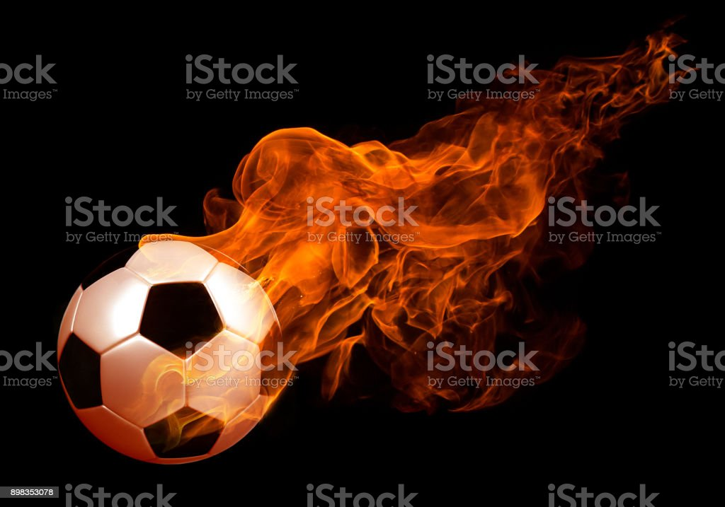 Image of soccer ball in fire flames against black background stock photo