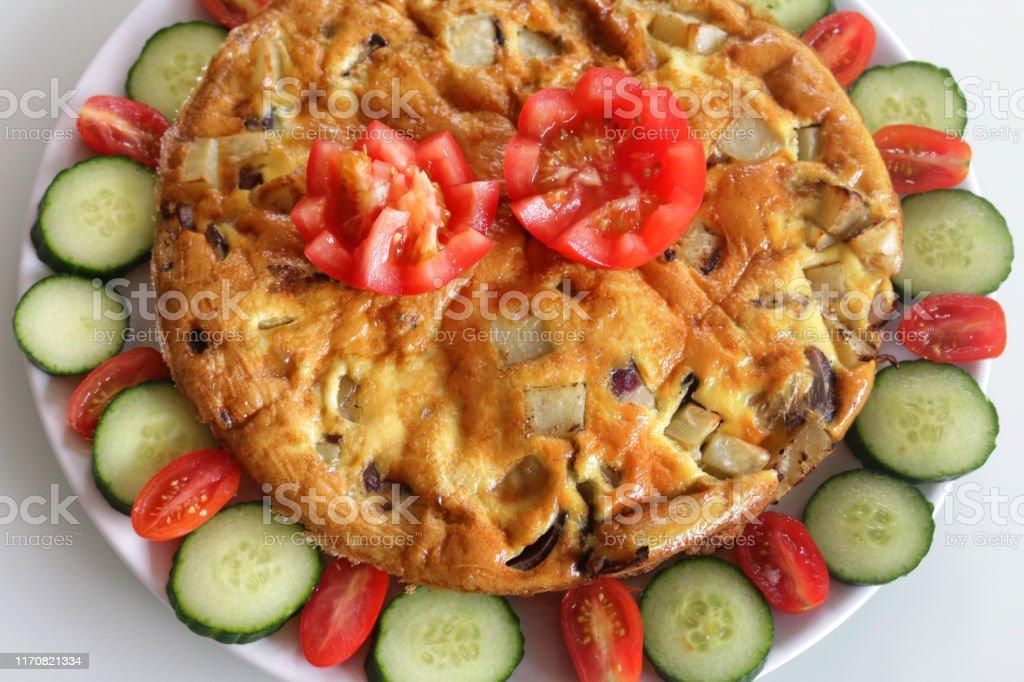 Stock photo of Spanish omelette omelet tortilla served on white plate...