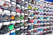Image of sport colorful shoes on showcase of sports shop