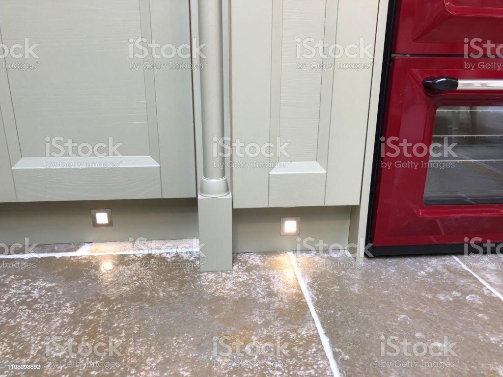 Image Of Spot Halogen Lights Under Grey Kitchen Cabinets Cupboards