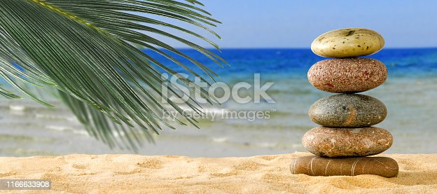 image of stones in the sand on a green background
