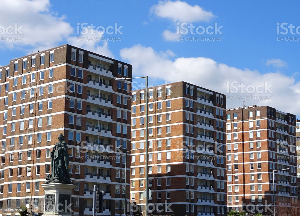 Wonderful Image Of Tall Blocks Of Red Brick Flats / Dated 1970s Apartment Blocks  Royalty