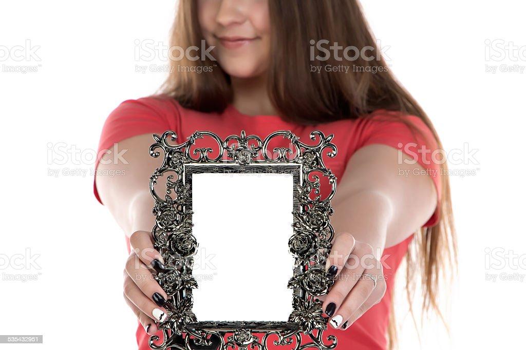 Image of teenage girl showing photo frame stock photo