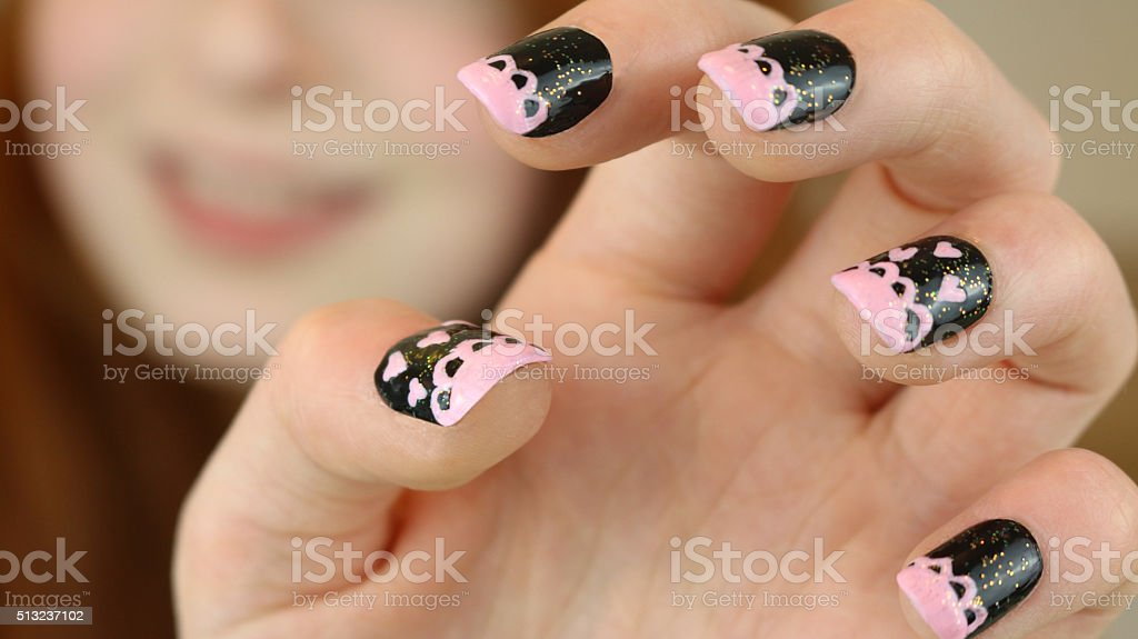 Image of teenage girl's fingernails painted with a lacy design stock photo
