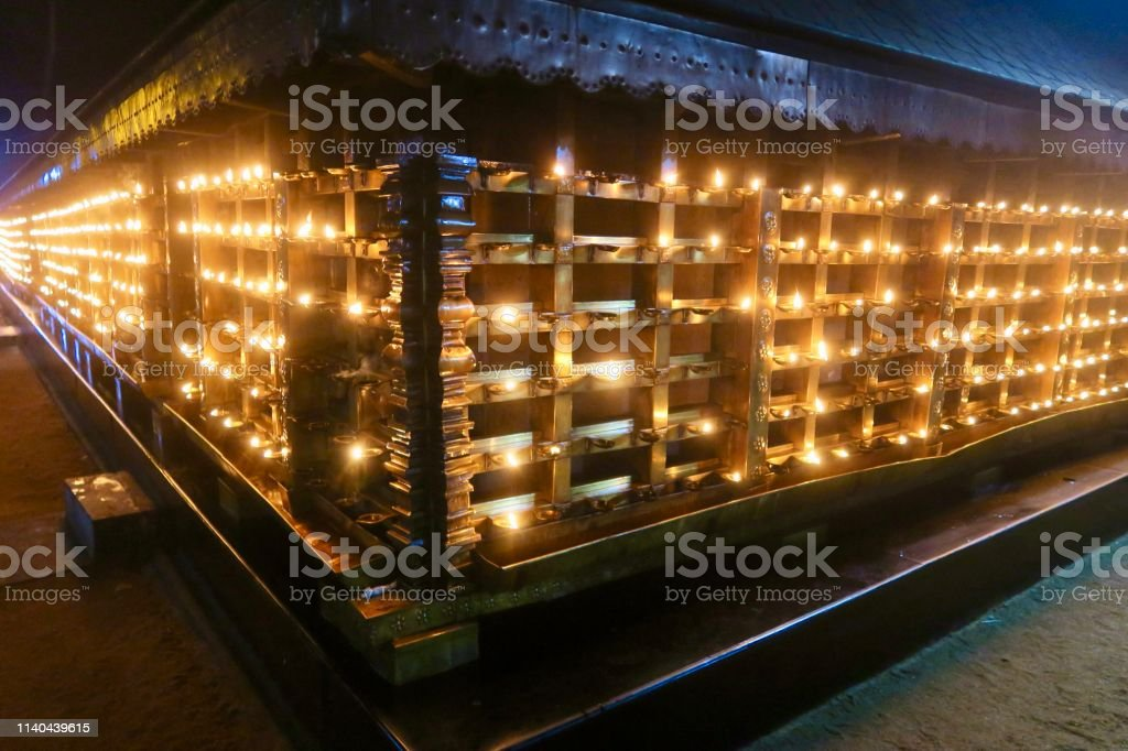 Candles lit by Hindu worshippers at a temple in Kollam, Kerala, South...