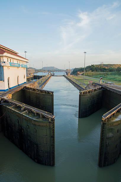 Image of the narrow Panama Canal under a blue sky stock photo