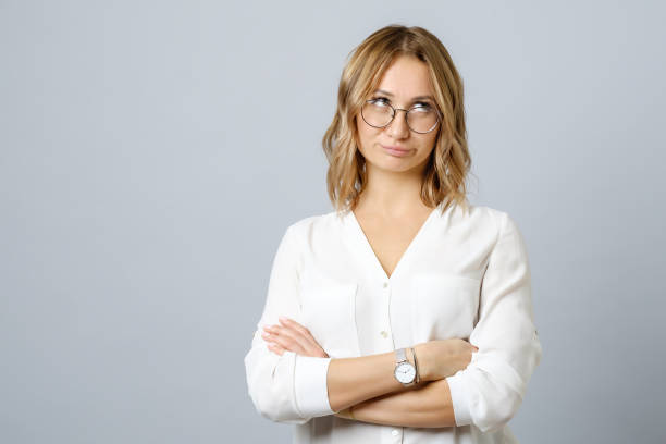 Image of thoughtful nervous young woman isolated over gray background stock photo