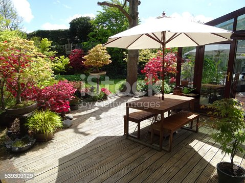 image of timber decking garden table with parasol upvcconservatory maples stock photo 539309129 istock