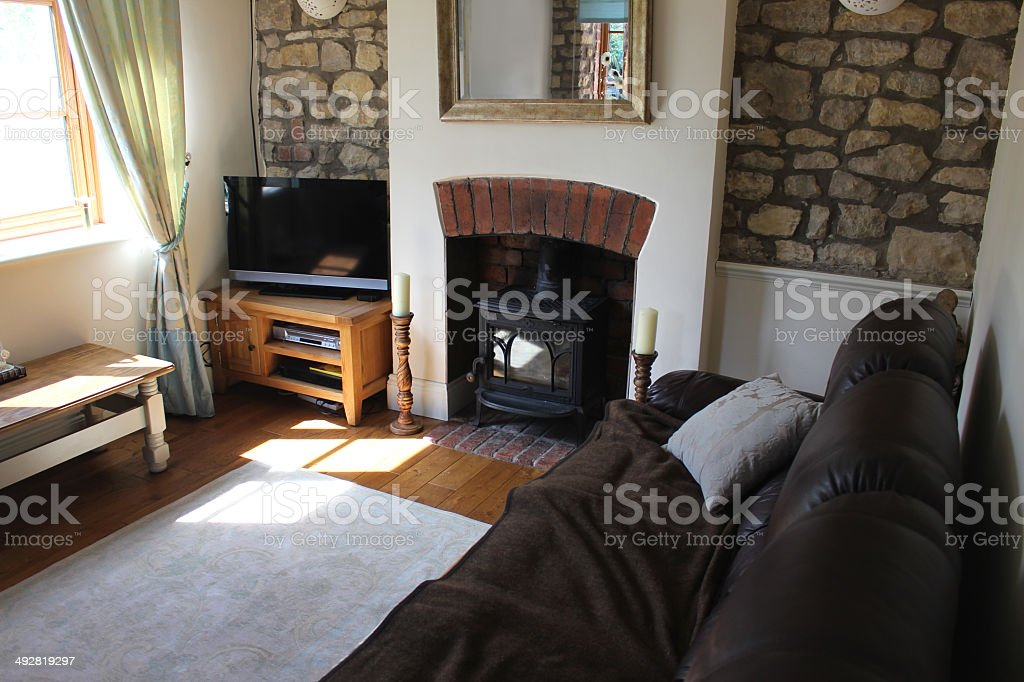 Image of traditional cottage sitting room / lounge, with leather sofa royalty-free stock photo