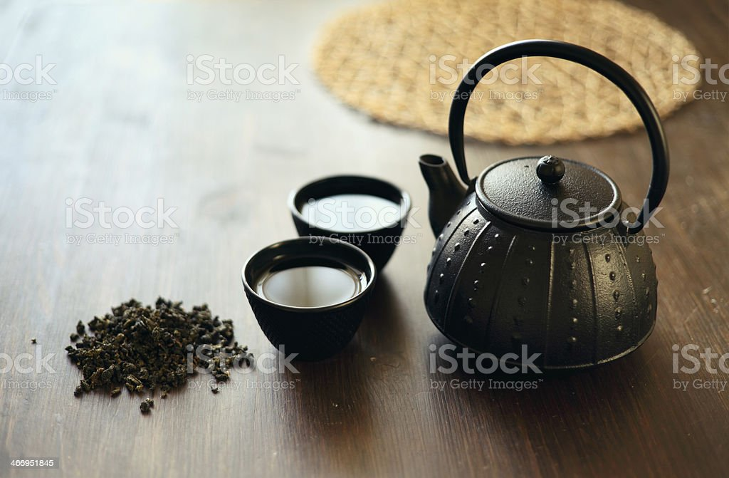 Image of traditional eastern teapot and teacups on wooden desk royalty-free stock photo