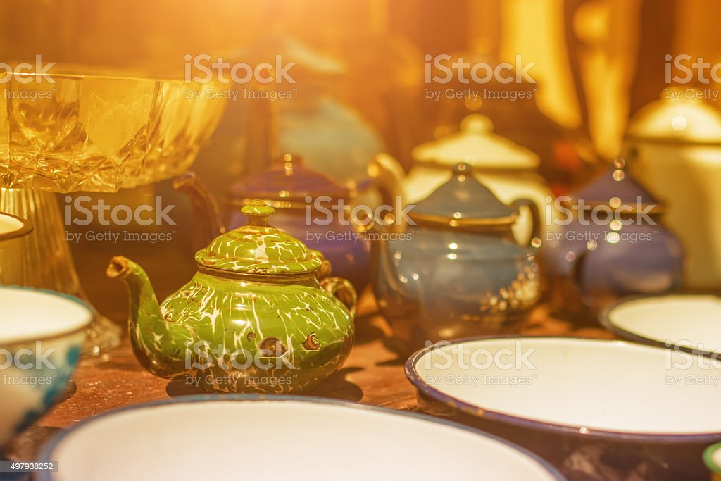Image of traditional eastern teapot and teacups on wooden desk stock photo