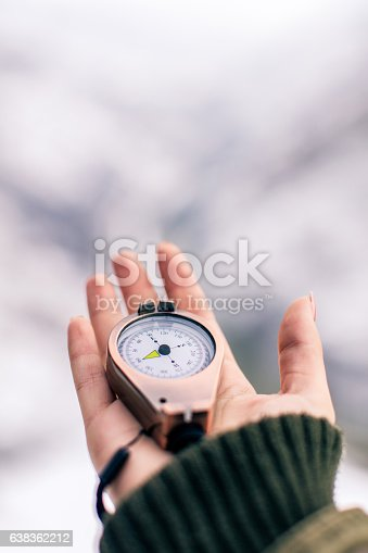 POV image of traveler woman with a compass