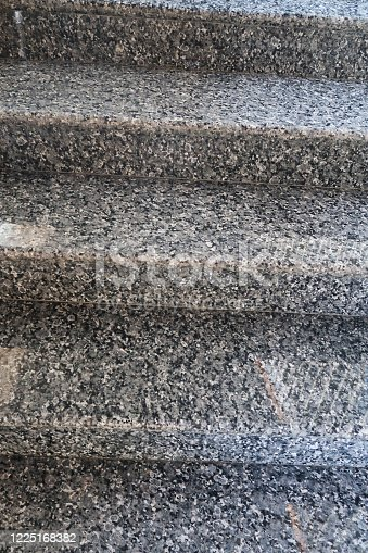 Stock photo looking up a flight of highly polished grey, granite steps on a modern staircase.