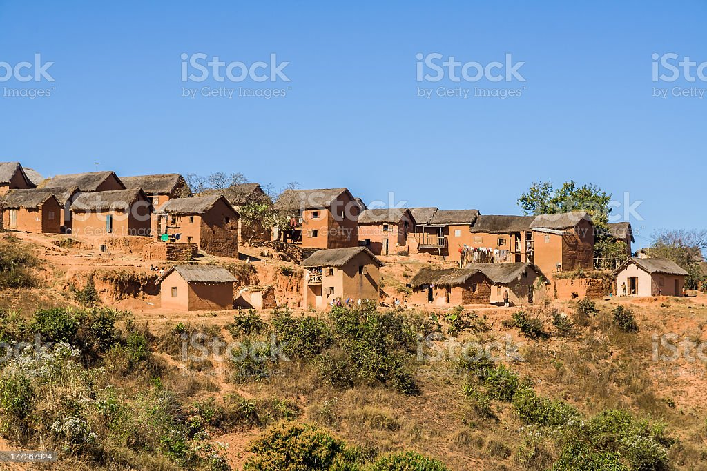 Image of village consisting of beige peaked-roof buildings stock photo