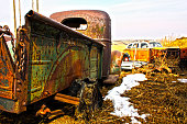 HDR Image of Vintage, old Cars and Trucks in a farm