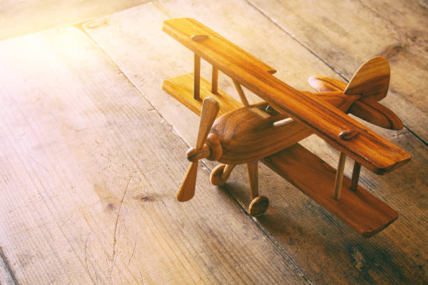 image of vintage old toy airplane over old table - foto de stock