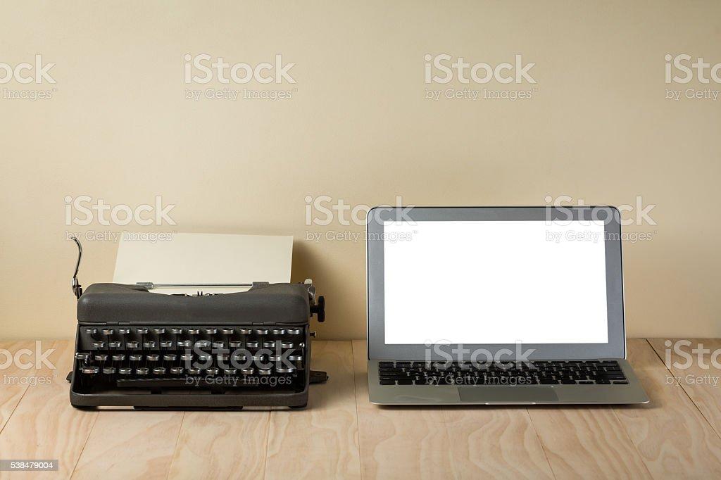 Image of vintage typewriter and modern laptop stock photo