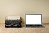 Image of vintage typewriter and modern laptop