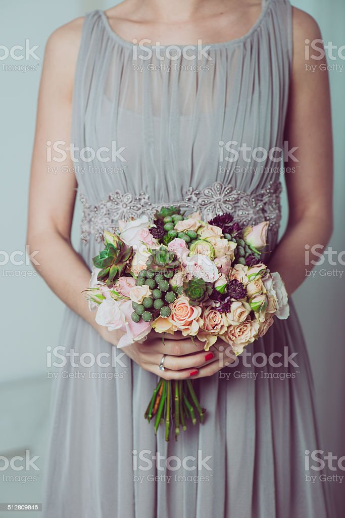 Image of wedding dress and floral bouquet. stock photo