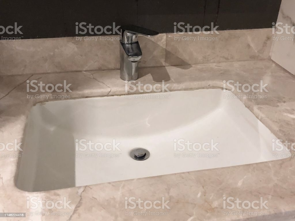 Image Of White Rectangular Recessed Ceramic Sink In Bathroom Washroom Interior Design With Luxury Cream And Beige Indian Marble Tiles Countertops And Splash Back Modern Contemporary Stainless Steel Mixer Tap Photo With