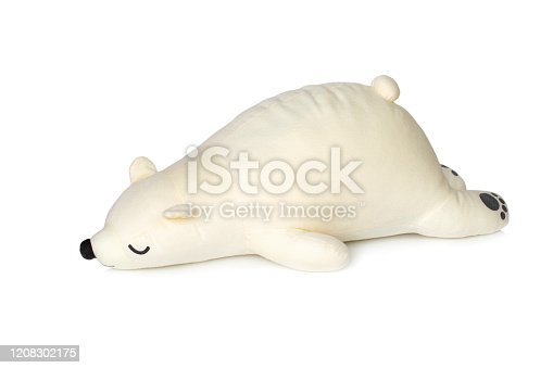 Image of white teddy bear is sleeping isolated on white background. Animal dolls.