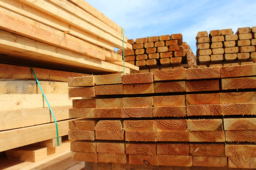 Image of wood planks / sawmill posts in timber yard piles