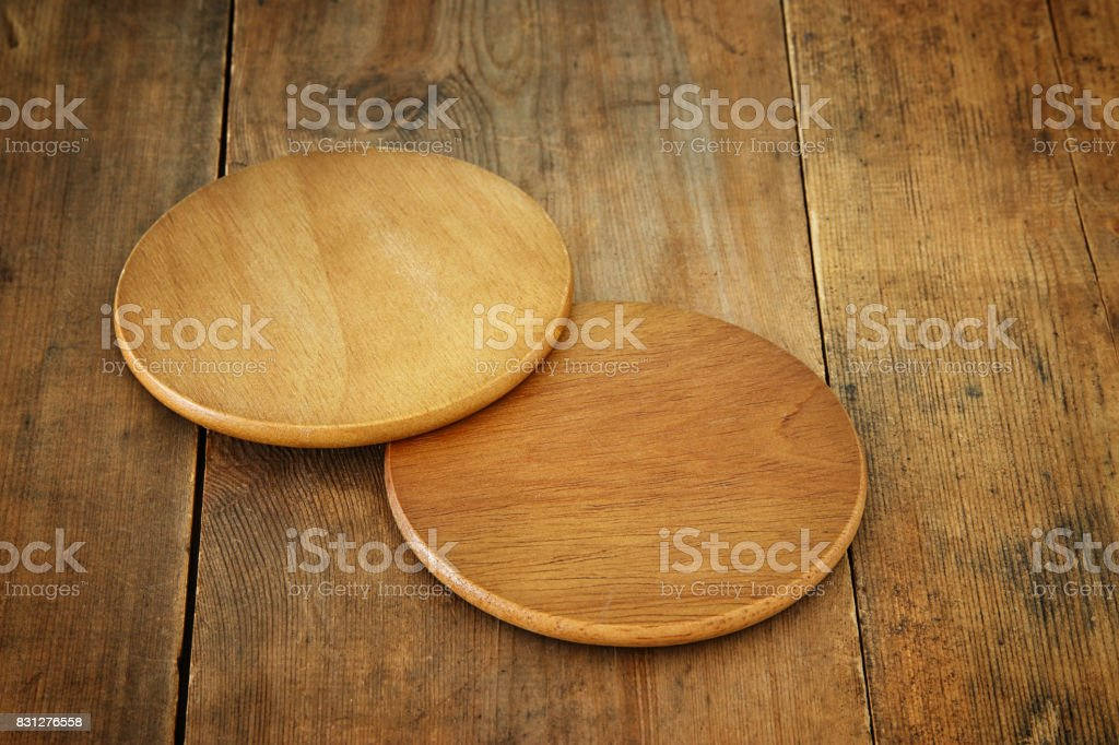 image of wooden beer coasters on textured table background stock photo