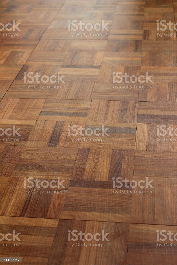 Image of wooden parquet flooring squares, varnished wood floor tiles stock photo