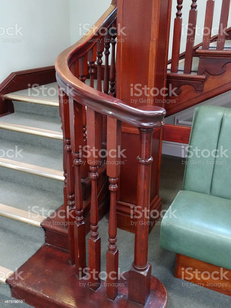 Image Of Wooden Stair Bannisters / Spindles, Staircase, Green Carpet, Metal