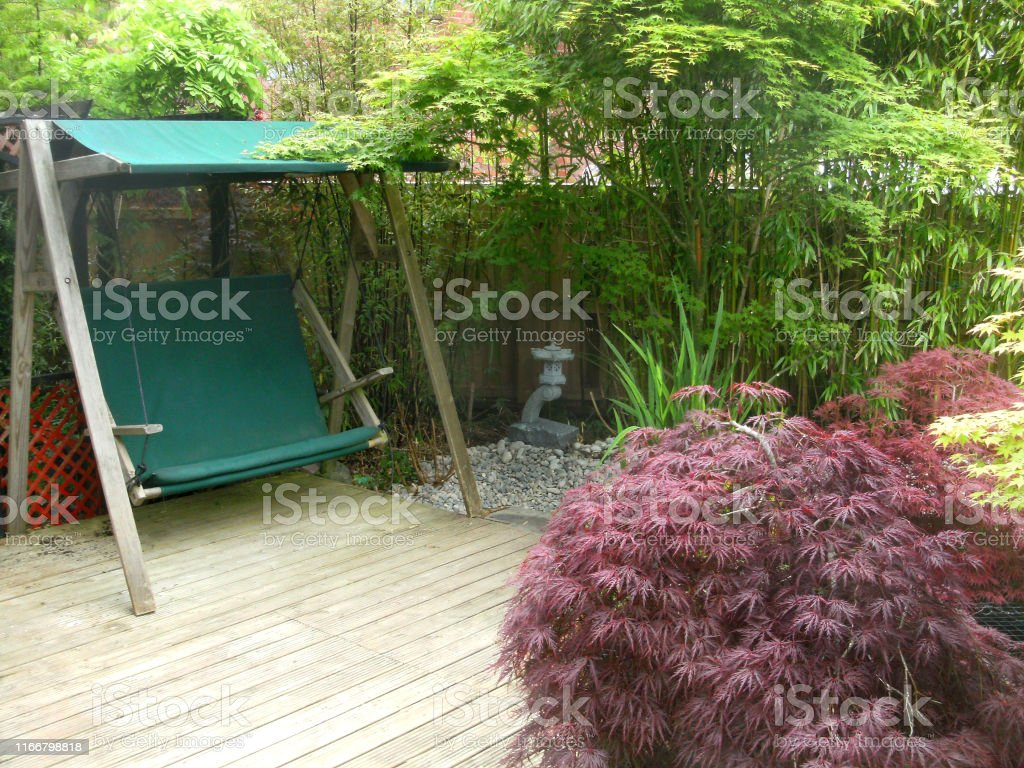 Image Of Wooden Swing Seat In Garden Featuring Japanese Elements