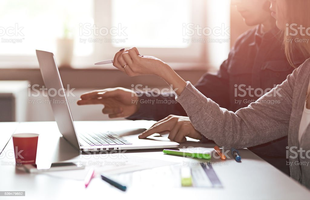 Image of young Business Team discussing Project at Computer stock photo