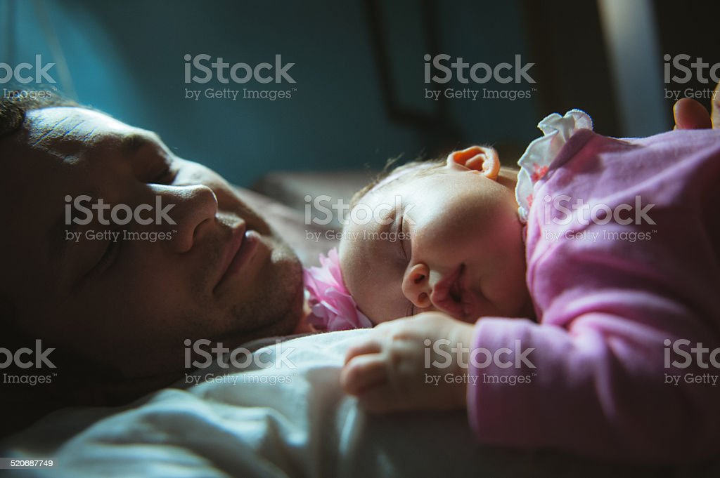 Image of young dad with cute little daughter in his stock photo