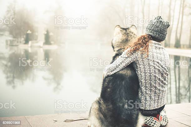 Image of young girl with her dog alaskan malamute outdoor picture id626901968?b=1&k=6&m=626901968&s=612x612&h=vf1gdlmd93ars2zir1ppjaa40umxs9qae7hoh6azodc=