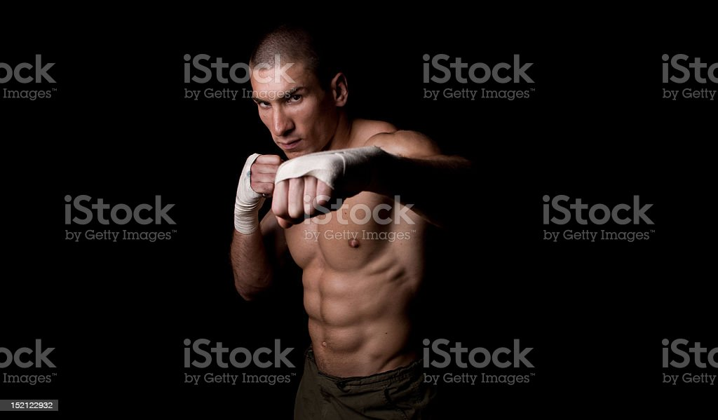 Image of young man boxing into camera royalty-free stock photo