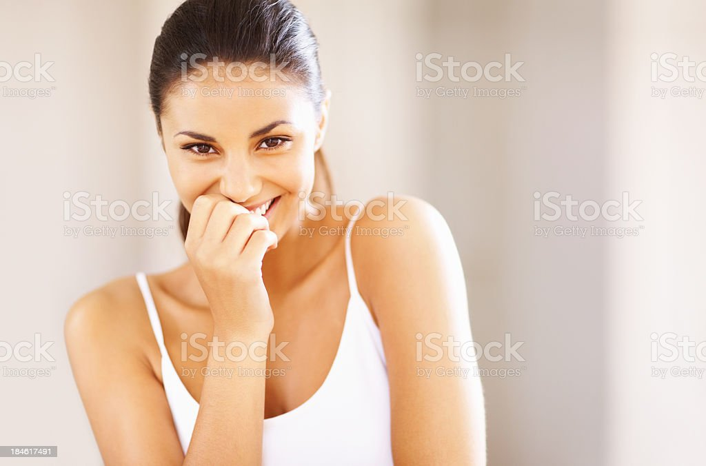 Image of young woman covering her mouth while laughing stock photo