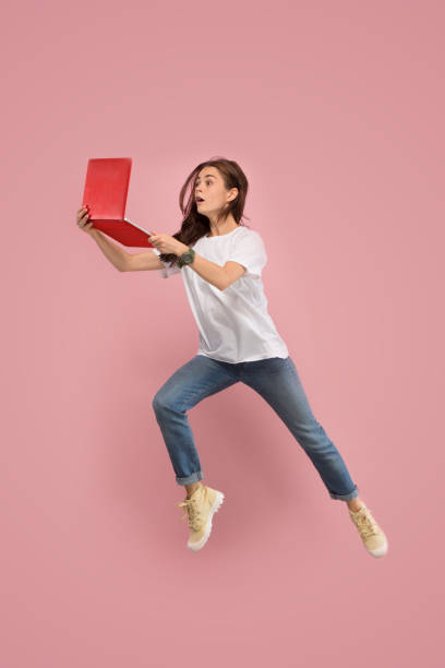 Image of young woman over pink background using laptop computer or picture id1043558296?b=1&k=6&m=1043558296&s=612x612&w=0&h=diaizqkdn2p7aixetaogvasd  xqy76liernb7r3sn0=