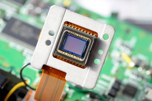 Image sensor of digital camera in front of circuit board stock photo